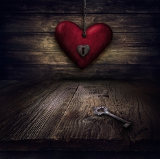 Valentines design - Locked Heart in chains. Love concept Illustration with heart hanging on chains with keyhole and vintahe key on wooden background.